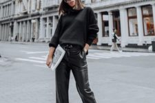 a black sweater, black cropped leather pants, brown velvet shoes with embellishments