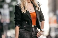 a bold casual outfit with a black cropped blazer, an orange top, black jeans, a black bag