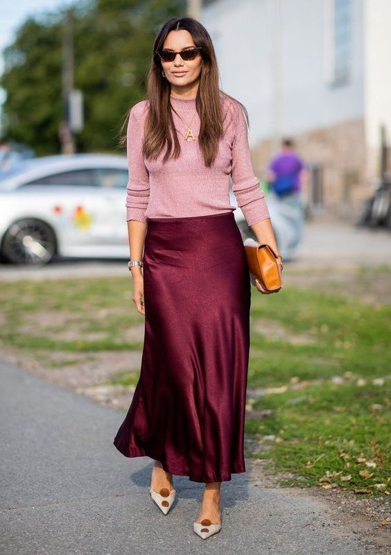 a burgundy slip skirt, a pink top, a brown clutch and two tone shoes for a spring or fall look