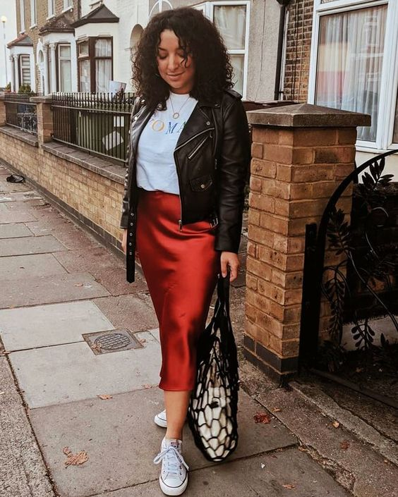 a casual look with a printed tee, a burgundy slip skirt, white sneakers, a black leather jacket
