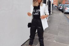 a casual monochromatic look with a printed black tee, black leather sporty pants, black platform shoe,s a white blazer and a black bag
