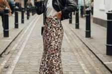 a casual spring outfit with a white tee, an animal print slip skirt, a black leather jacket and white sneakers