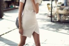 a casual summer work look with a neutral top, a matching asymmetrical mini skirt, black sneakers and a bag