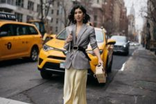 a catchy work look with a black top, an oversized blazer, a yellow slip skirt and bold shoes