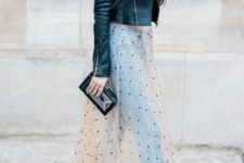 a crop top, blue jeans, a sheer polka dot skirt, blakc shoes, a cropped jacket and a cluch