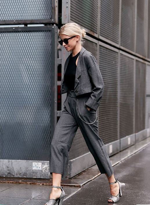 a grey pantsuit with a cropped blazer, cropped pants, a black halter top, silver shoes for work