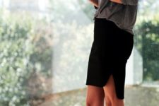 a grey top, a black asymmetrical mini skirt, black lace up shoes for a professional look