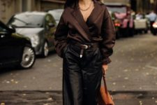 a luxurious outfit with a brown blouse, a statement necklace, black bermudas, brown lace up shoes and a brown bag