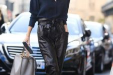 a navy shirt, black leather pants with a high waist, silver shoes and a grey bag for a comfortable work look