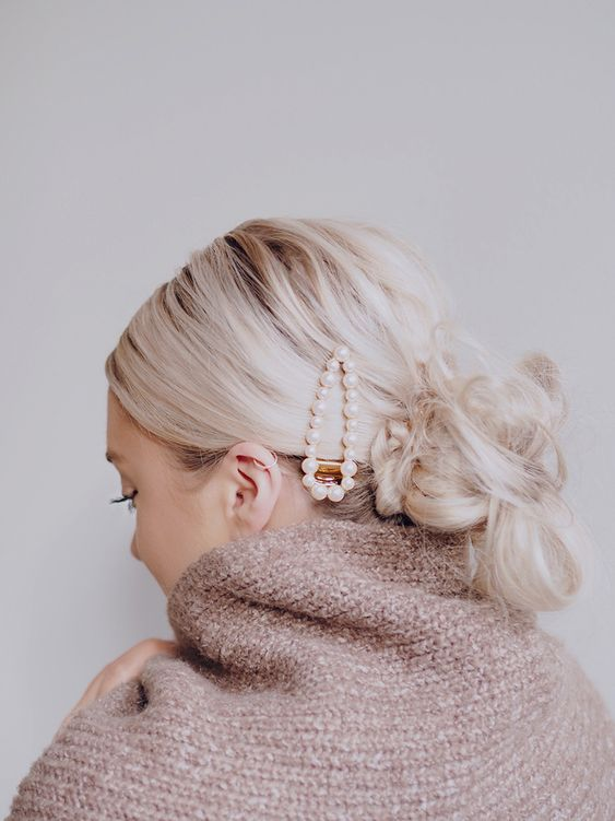 a pearl hair barrette is a nice idea that is on right now, every fashionista is trying that