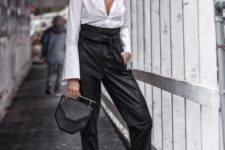 a refined work outfit with a white shirt, super high waisted black leather pants, blush shoes and a geometric bag