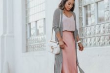 a romantic look with a blush top, a pink slip midi, strappy heels, a striiped duster and a white crossbody