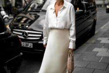 a spring look with a striped shirt, a neutral slip midi skirt, neutral slippers and a blush tassel bag