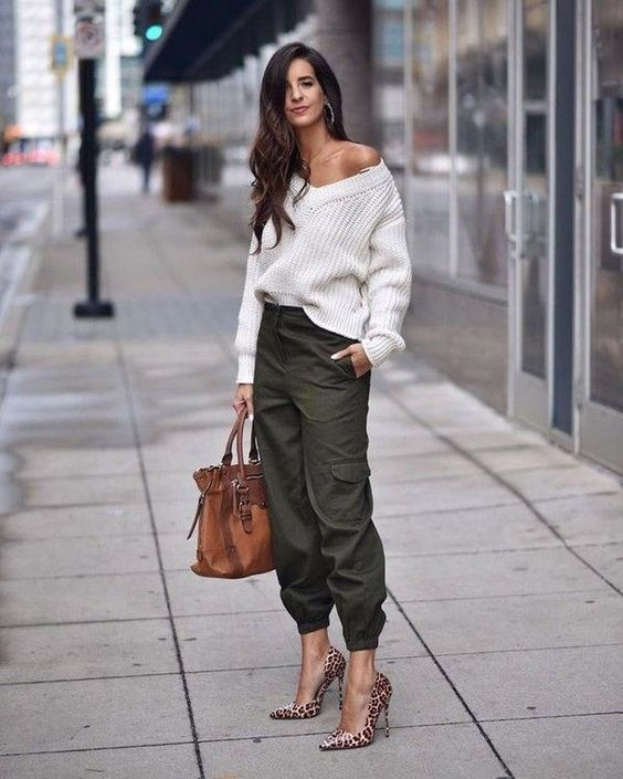 a spring look with a white one shoulder sweater, green cargo pants, animal print shoes and a brown bag