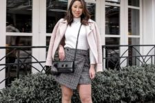 a spring work look with a white turtleneck, a grey plaid asymmetrical mini, black booties and a pink coat