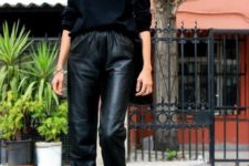 a stylish outfit with a black turtleneck, black leather pants, black peep toe booties and a black tote