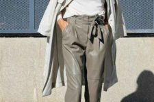 a stylish spring work look with a white tee, an off-white trench, grey high waisted leather pants, animal print shoes
