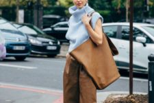 a trendy spring outfit with a powder blue oversized sleeveless turtleneck, brown leather bermudas, an oversized tote and turquoise heels