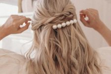 a stylish half updo hairstyle with a hairstyle