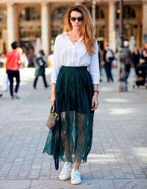 a white long sleeve top, a green mini plus a sheer lace green maxi skirt, white sneakers and a black clutch