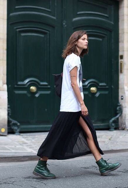 a white printed oversized tee, a black sheer skirt, green combat boots for a bold spring look