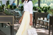 a white shirt, a light yellow pleated asymmetrical midi skirt, white heels and a white bag for work