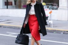 a white shirt, a red asymmetrical midi skirt, black shoes, a black coat and a bag