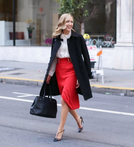 a white shirt, a red asymmetrical midi skirt, black shoes, a black coat and a bag