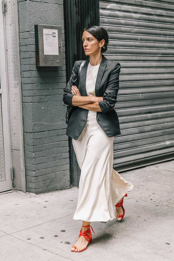 a white tee, a neutral slip skirt, red strappy shoes and a black blazer to wear to work