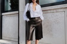 a work look with a white shirt, black leather bermudas and black strappy shoes plus a black bag