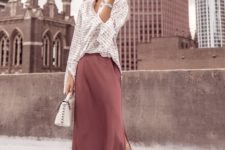 a work outfit with a striped shirt, a mauve slip skirt, silver heels and a white bag for spring