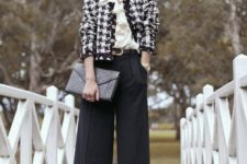 a work outfit with a white blouse, a cropped tweed blazer, black palazzo pants and a clutch