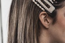 an arrangement of matching pearl hair clips is a cool way to accessorize your medium or short hair