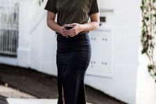 an olive green tee, a black asymmetrical midi pencil skirt, black flats for a summer work look
