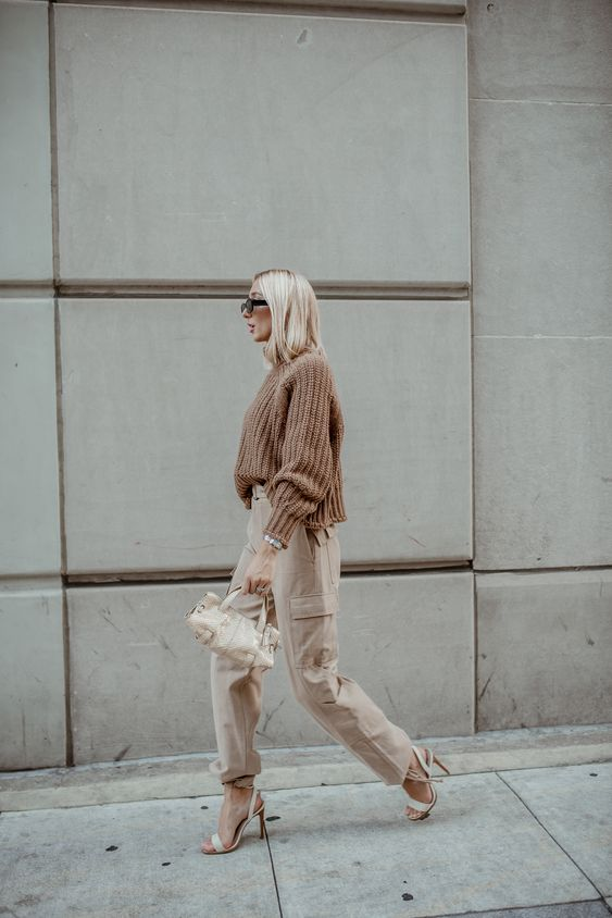 an oversized dusty rose sweater, tan cargo pants, white shoes and a smll bag for now