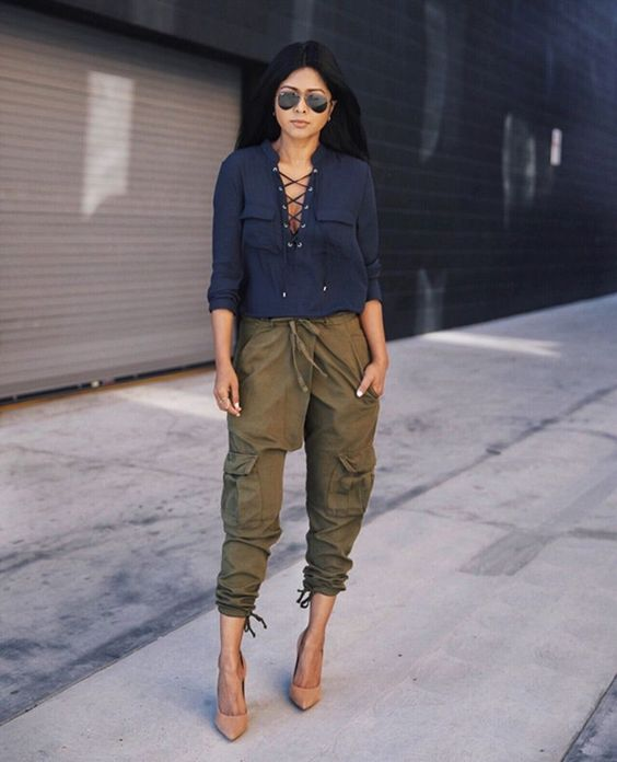 green cargo pants, a navy lace up blouse and tan heels for a bold spring look