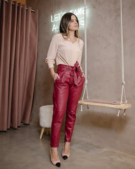 red high waisted pants, two tone shoes, a blush shirt for a catchy and bright work look