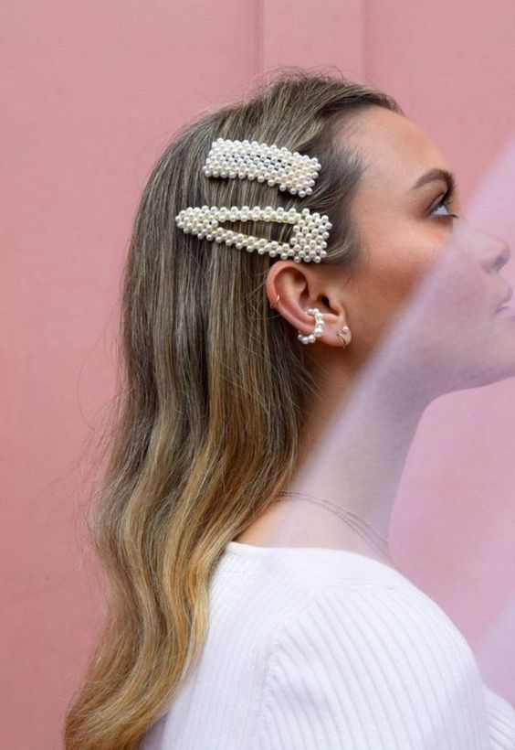 statement pearl hair clips paired with a matching ear cuff for a bold contemporary look