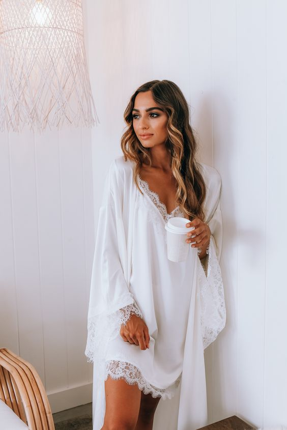 a beautiful white nightgown with a lace trim and a matching long robe for really a romantic look
