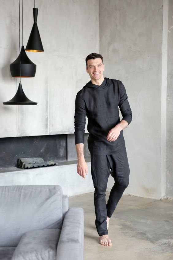 a black linen suit with pants and a hoodie is a cool idea for a sporty and modern look