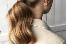 02 a wavy low ponytail with a sleek top is a cool and stylish idea for a modern girl