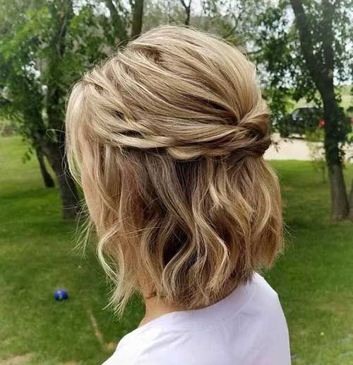 a blonde half updo with twists and two braids plus waves is a cool idea to wear every day