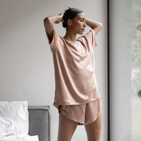 pink silk pajamas with an oversized tee and wide shorts are perfect for sleeping and not only