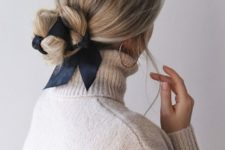 07 a low twisted updo all tied up with a navy ribbon and with a sleek top is a chic and girlish idea