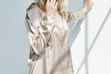 07 dove grey silk pajamas with a deep cut top and shorts and a matching longer robe to rock