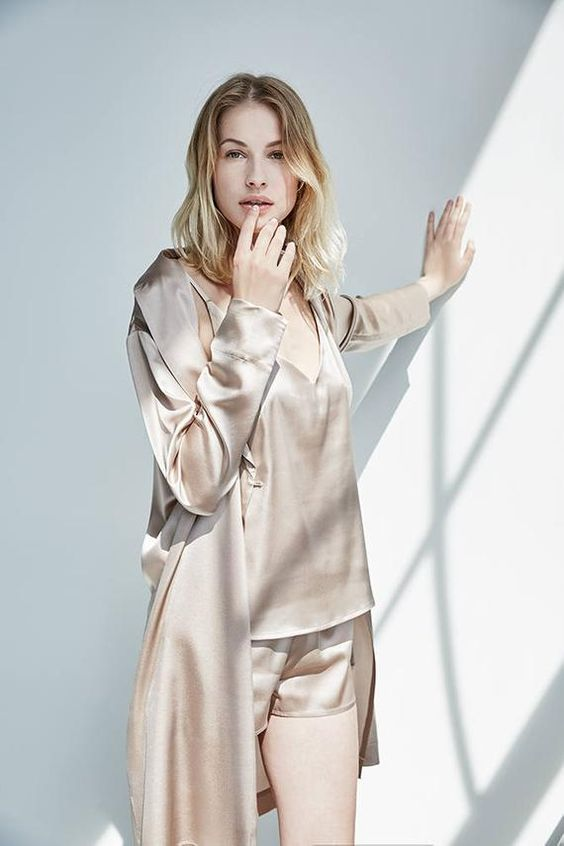 dove grey silk pajamas with a deep cut top and shorts and a matching longer robe to rock