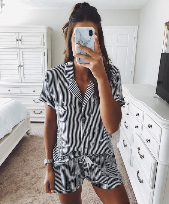 a simple and modern striped pajama set with short sleeves and shorts to wear for sleeping and lounging