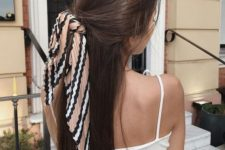 10 a simple and casual half updo styled with a printed hair tie is a trendy idea for now