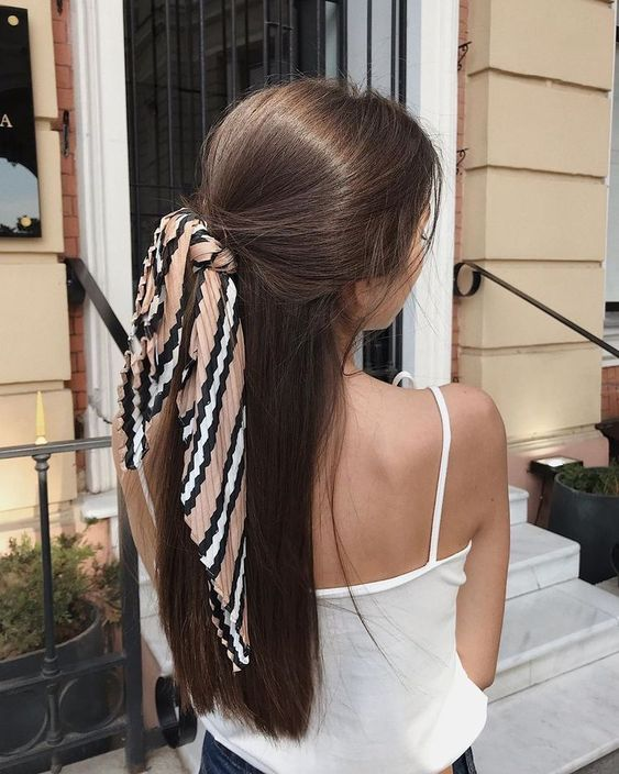 a simple and casual half updo styled with a printed hair tie is a trendy idea for now
