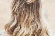 11 a simple half updo with a bun and waves down is a cool idea for both medium and long hair